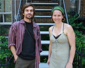 man and woman stand in front of outdoor stairway