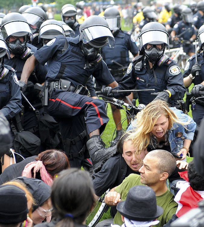 G20-Toronto-Police-Kicking-Unarmed-and-Tied-Up-Civilians