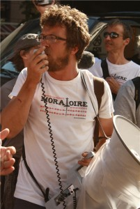 man holds megaphone and microphone to mouth