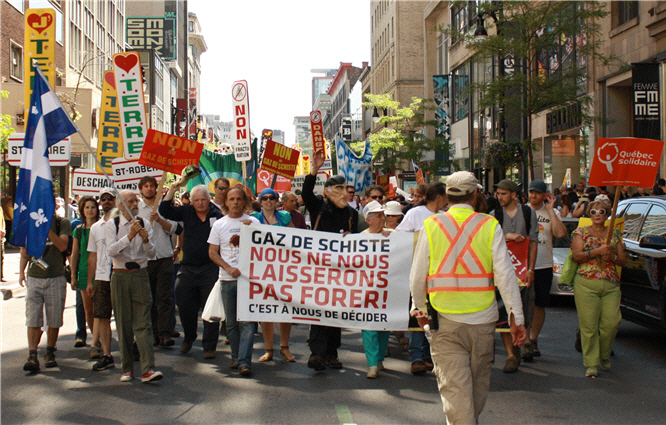 protesters march in downtown Montreal