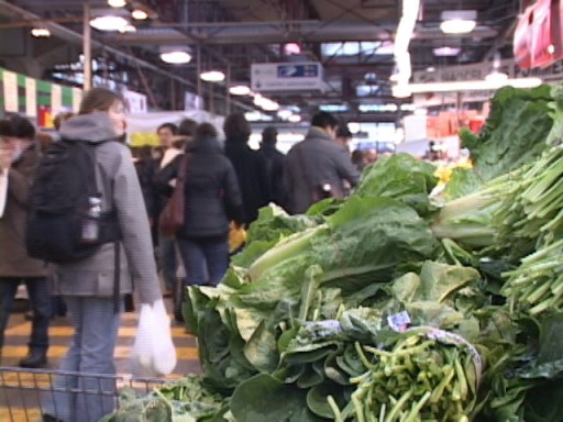 vegetables and people in an indoor market