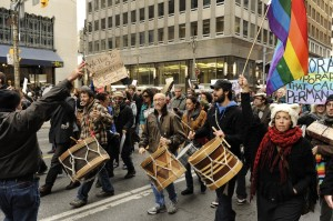 marchers and drummers walk on the street