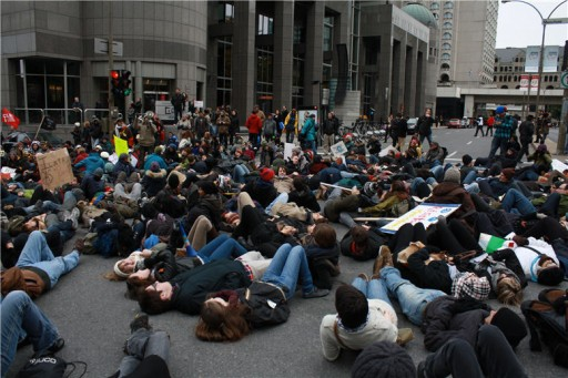 Protesters lying down in the street