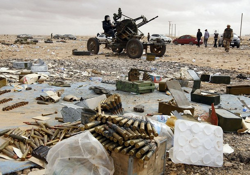 A rebel mans an anti-aircraft gun in Ras Lanuf, Libya