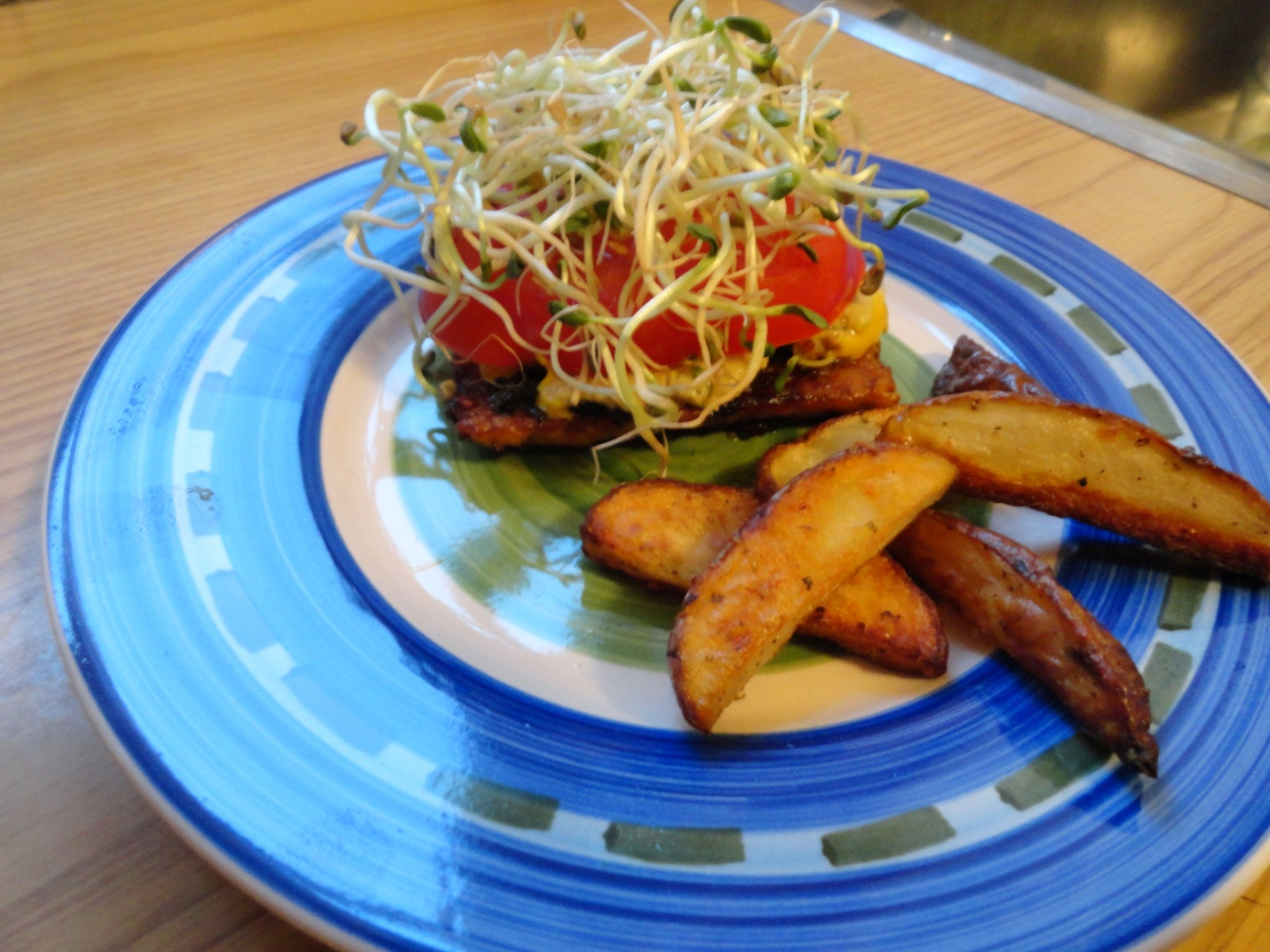 Tempeh burger with mustard, tomato, sprouts and a side of fries!
