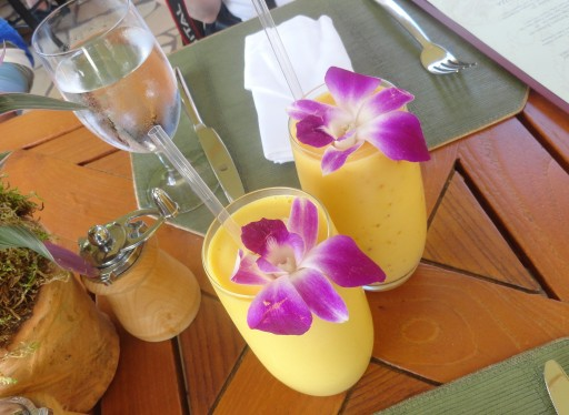 Mango Pineapple Smoothie with edible orchid