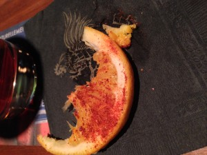 Orange with chili, dried worm