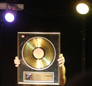 Steve Mahon holding up his Gold record