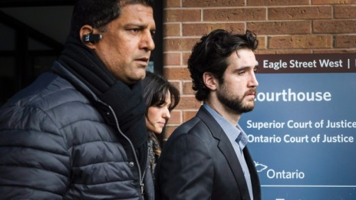 Marco Muzzo (right) leaves the courthouse (image: Canadian Press)